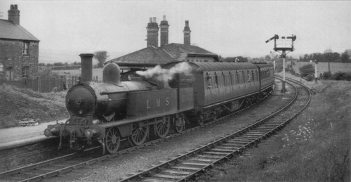 LMS_Ex-LNWR-2-4-2T_6713_Holland_Arms_Station.jpg